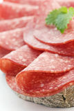 Salami Bread. Salami slices with Bread as close up royalty free stock photo