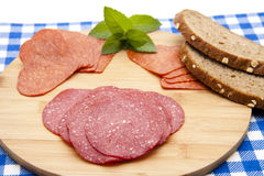 Salami with bread Stock Photography