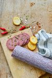 Salami and bread. Bread slices and Bruschetta with different kinds of Salami , peperoncino, fresh onion and spices as a rustic lunch stock photography