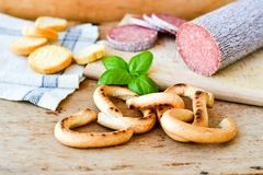 Salami and bread. Bread slices and Bruschetta with different kinds of Salami , peperoncino, fresh onion and spices as a rustic lunch stock photos