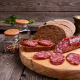 Salami and bread on a cutting board Royalty Free Stock Photo
