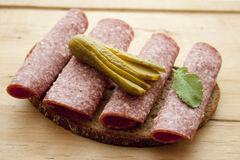 Salami bread with gherkin Stock Photos