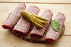 Salami bread with gherkin Stock Photos