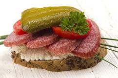 Salami bread with gherkin Royalty Free Stock Photo