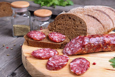 Salami and bread on the kitchen table Stock Photo