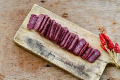 Salami. Bread slices and Bruschetta with different kinds of Salami , peperoncino, fresh onion and spices as a rustic lunch royalty free stock photo
