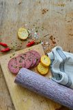 Salami and bread. Bread slices with salami and spices as a rustic lunch stock photo