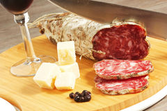 Salami and cheese. On a wood table Royalty Free Stock Image