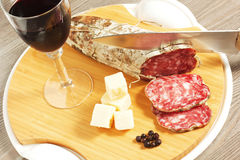 Salami and cheese. On a wood table Stock Photos