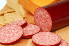 Salami with cheese and crackers Stock Photos