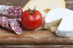 Salami and cheese. Mediterranean delicacy, salami and cheese with red tomato as food backgrounds Stock Photo