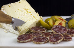 Salami, Cheese and Olives. Serving of salami, cheese and olives as an horderve before dinner Stock Photo