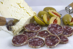 Salami, Cheese and Olives. Serving of salami, cheese and olives as an horderve before dinner Stock Image