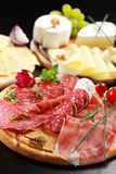 Salami and cheese platter with herbs. Salami and cheese platter with vegetable and herbs Royalty Free Stock Photo