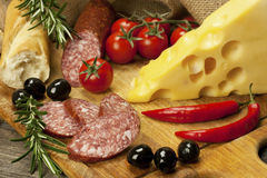 Salami and cheese platter with vegetable and herbs Stock Images