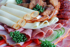 Salami and cheese rolls with vegetables Royalty Free Stock Photography