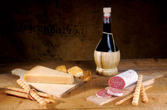 Salami cheese and wine. Seasoned salami sliced a Italian snack royalty free stock photos