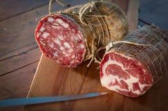 Salami close-up, landscape. Close-up on delicious salami on a board. Landscape orientation Stock Photos