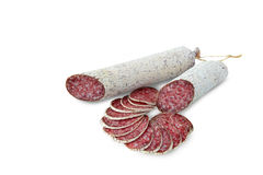 Salami - closeup of dried sausages. Salami closeup of dried sausages isolated on white background Royalty Free Stock Photo