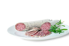 Salami - closeup of dried sausages. Salami closeup of dried sausages on white plate isolated on white background royalty free stock image