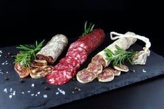 Salami con romero y pimienta foto de archivo libre de regalías