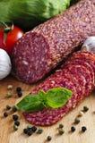 Salami coupé en tranches Photographie stock
