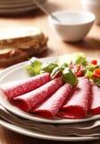 Salami coupé en tranches Images stock