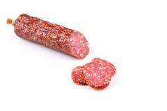 Salami coupé en tranches Photos libres de droits