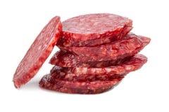 Salami coupé en tranches d'isolement Images stock