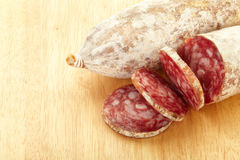 Salami on cutting board Royalty Free Stock Photos