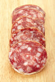 Salami on cutting board Stock Photo