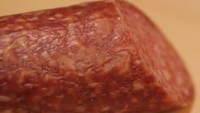 Salami. On a cutting board closeup stock video
