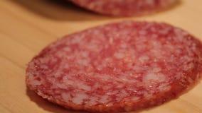 Salami. On a cutting board closeup stock footage