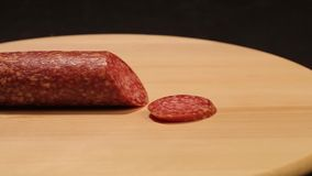 Salami. On a cutting board closeup, sausage stock video