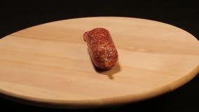 Salami. On a cutting board closeup, sausage stock video footage