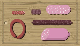Salami on a cutting board. Different kinds of salami on a cutting board Royalty Free Stock Photo