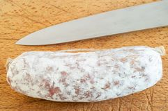 Salami on cutting board Royalty Free Stock Photography