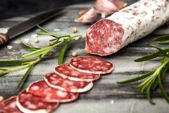 Salami on dark background. Traditional italian salami on dark background stock images