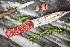 Salami on dark background Royalty Free Stock Images