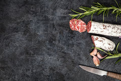 Salami on dark background Stock Photography