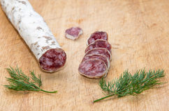 Salami with dill Stock Photo