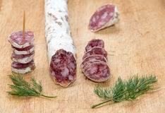 Salami with dill Stock Images