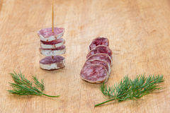 Salami with dill Royalty Free Stock Image