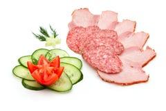 Salami e presunto cortados Foto de Stock