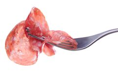 Salami On Fork Royalty Free Stock Image