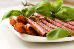 Salami with fresh basil Royalty Free Stock Images