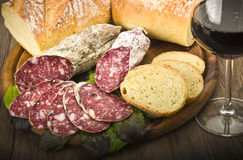 Salami and glass of Red wine royalty free stock image