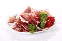 Salami and ham. Very tasty sliced salami with prosciutto royalty free stock images