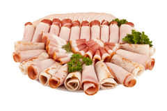 Salami ham meat and more on the plate isolated on the white back Royalty Free Stock Photography