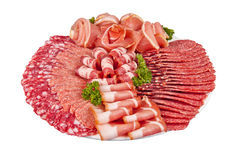 Salami ham meat set. Salami ham meat and more on the plate isolated on the white background royalty free stock photo